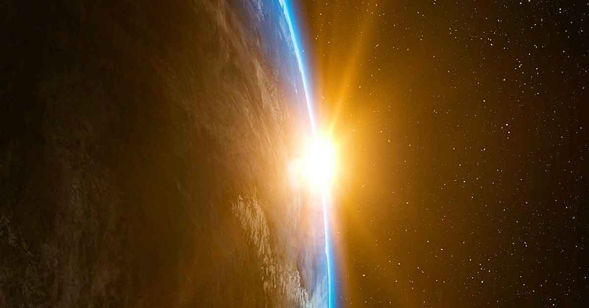 Vista de la tierra y el sol desde el universo